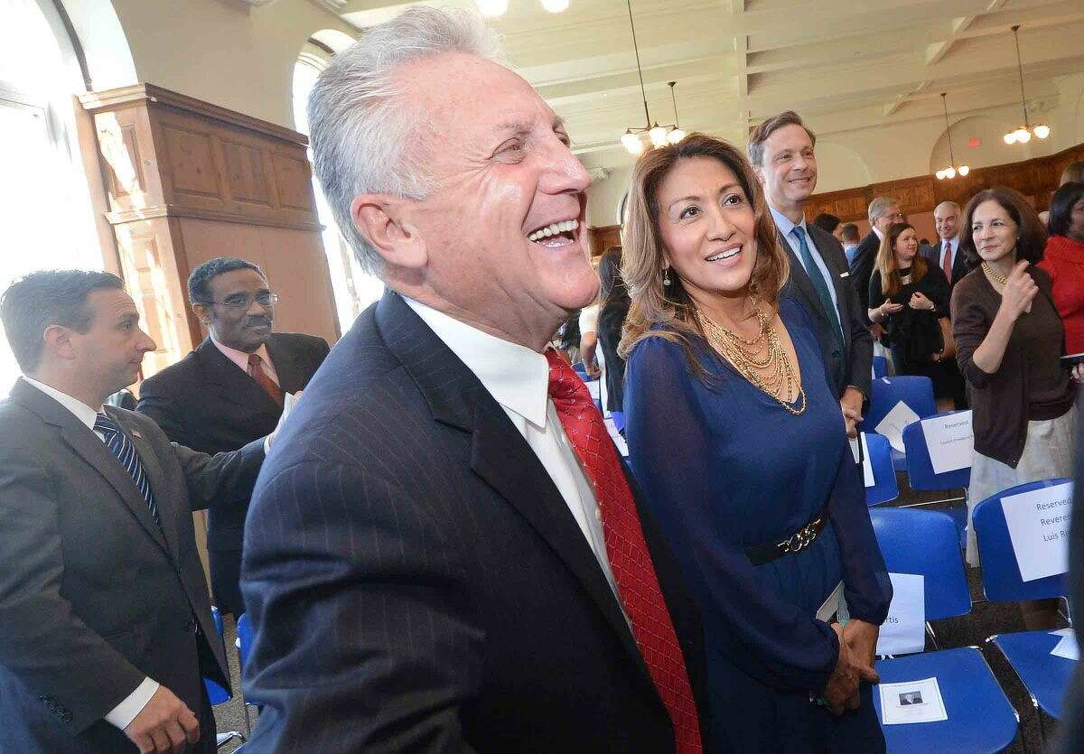 Hour Photo/Alex von Kleydorff In this file photo, Norwalk Mayor Harry Rilling and wife Lucia make their way to friends and family during a swearing in ceremony at City Hall on Tuesday.
