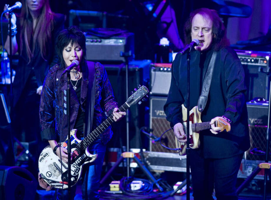 Joan Jett, left, performs with Tommy James at the 6th Annual Little Kids Rock benefit presented by Guitar Center at the Hammerstein Ballroom on Thursday, Oct. 23, 2014, in New York. (Photo by Stephen Chernin/Invision/AP)