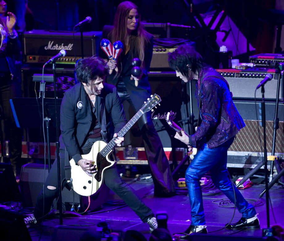 Billie Joe Armstrong, left, performs with Joan Jett at the 6th Annual Little Kids Rock benefit presented by Guitar Center at the Hammerstein Ballroom on Thursday, Oct. 23, 2014 in New York. (Photo by Stephen Chernin/Invision/AP)