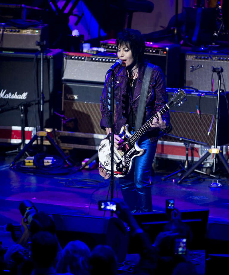 Joan Jett performs at the 6th Annual Little Kids Rock benefit presented by Guitar Center at the Hammerstein Ballroom on Thursday, Oct. 23, 2014 in New York. (Photo by Stephen Chernin/Invision/AP)