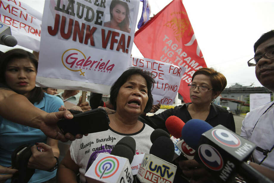 In this Saturday, Oct. 18, 2014 photo, Julita Cabillana, mother of killed transgender Jennifer Lauda, talks to reporters during a rally near the USS Peleliu, where U.S. Marine Pfc. Joseph Scott Pemberton is said to be held, at the Subic Bay free port, Zambales province, northern Philippines. The killing of Jennifer Laude, a 26-year-old transgender whose former name was Jeffrey, has sparked public anger in the Philippines and revived a debate over the U.S. military presence in a country seen by Washington as a major ally in Southeast Asia. (AP Photo/Aaron Favila)