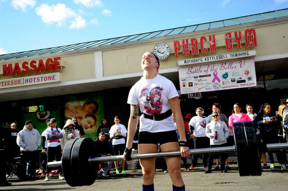 Kerry Theriault competes in the Battle of the Belles Sunday at Punch Gym in Norwalk money from the event will be donated to the Bennett Cancer Center at Stamford Hospital. Hour photo/Matthew Vinci