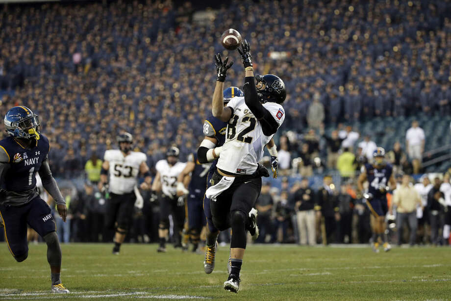 Army wide receiver Edgar Poe (82) catches a pass before running in a touchdown during an NCAA college football game against Navy Saturday, Dec. 12, 2015, in Philadelphia. (AP Photo/Matt Slocum)