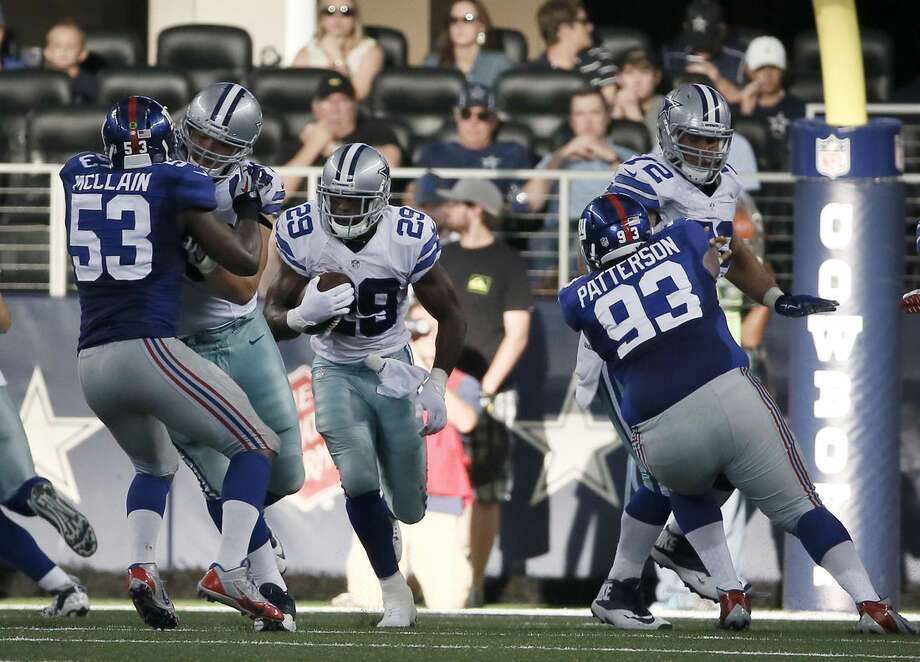 New York Giants' Jameel McClain (53) and Mike Patterson (93) defend as Dallas Cowboys' DeMarco Murray (29) finds the gap on a running play during the second half of an NFL football game, Sunday, Oct. 19, 2014, in Arlington, Texas. (AP Photo/Brandon Wade)