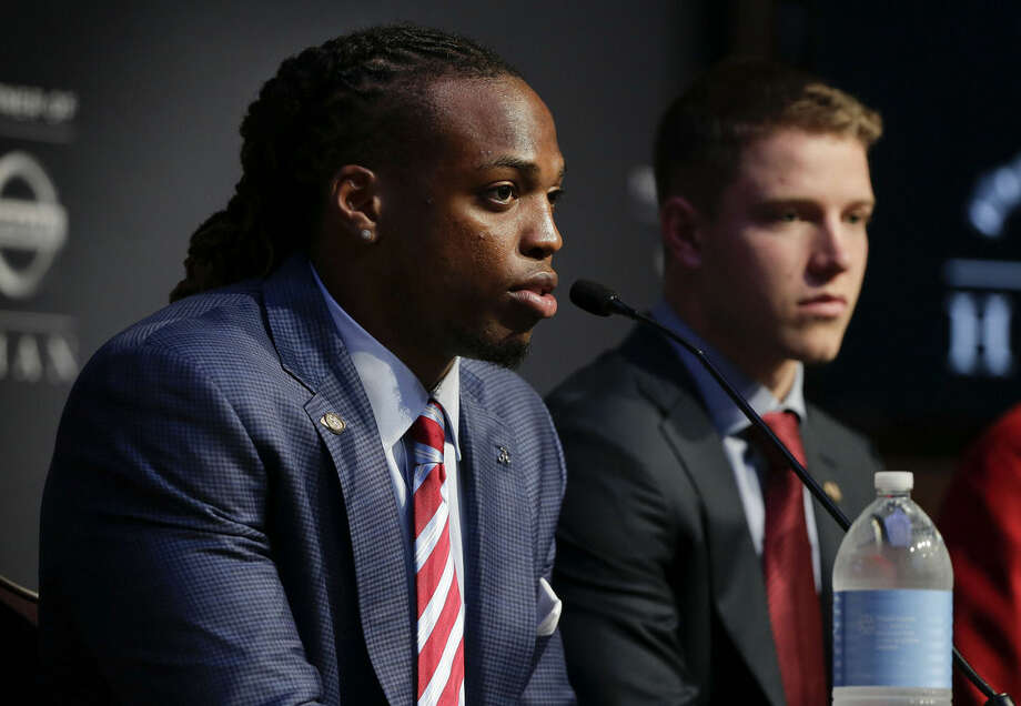 Alabama's Derrick Henry, left, answers questions for the media as Stanford's Christian McCaffrey looks on before the start of the Heisman Trophy award presentation show, Saturday, Dec. 12, 2015, in New York. (AP Photo/Julie Jacobson)