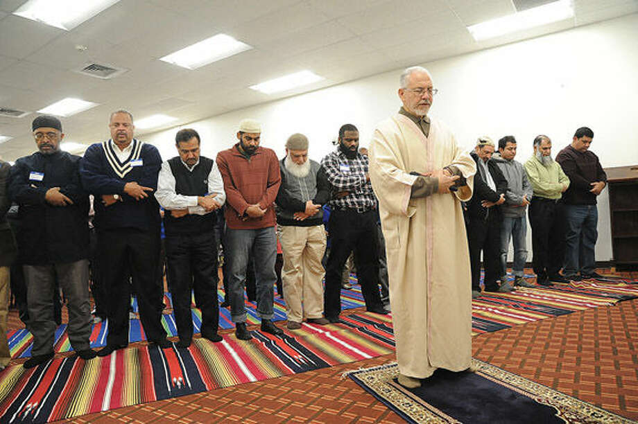 Azzeim Mahmoud, Imam for the al Madany Islamic Center in Norwalk leads a prayer Sunday. Elected officials and law enforcement met at the center to discuss how the community can work together to prevent discrimination and backlash against Muslims. Hour photo/Matthew Vinci