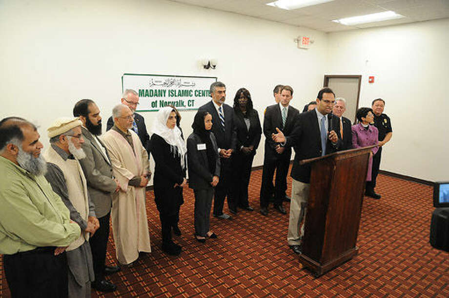 Elected officials and law enforcement met at the al Madany Islamic Center to discuss how the community can work together to prevent discrimination and backlash against Muslims. Hour photo/Matthew Vinci