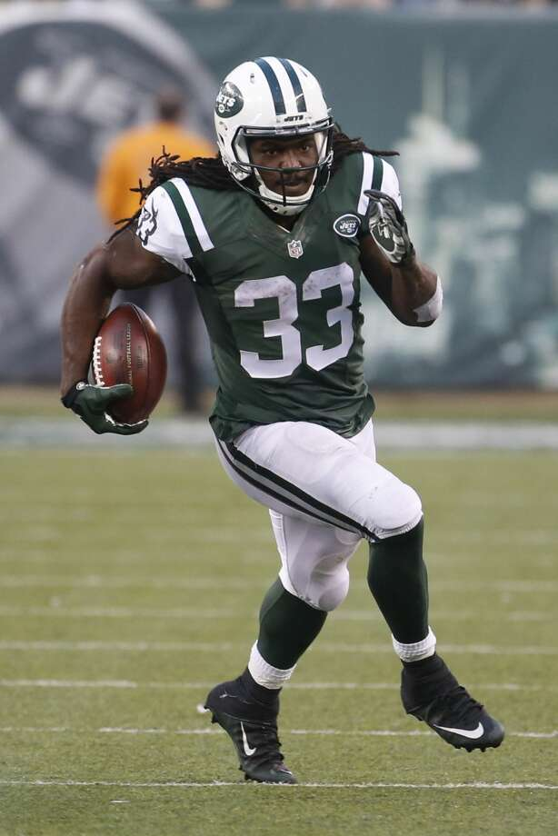 New York Jets running back Chris Ivory (33) rushes during the second half of an NFL football game against the Tennessee Titans Sunday, Dec. 13, 2015, in East Rutherford, N.J. (AP Photo/Julio Cortez)