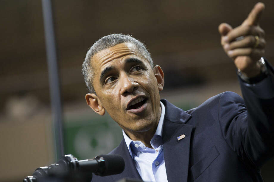 President Barack Obama delivers remarks during a campaign rally for Gov. Pat Quinn, D-Ill., at Chicago State University on Sunday, Oct. 19, 2014, in Chicago. (AP Photo/Evan Vucci)