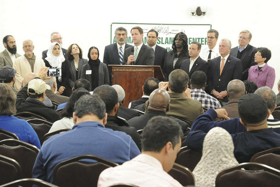 Hour photo/Matthew VinciConnecticut 4th district Congressman Jim Himes speaks Sunday where electedofficials and law enforcement met at the al Madany Islamic Center to discuss how the community can work together to prevent discrimination and backlash againstMuslims.