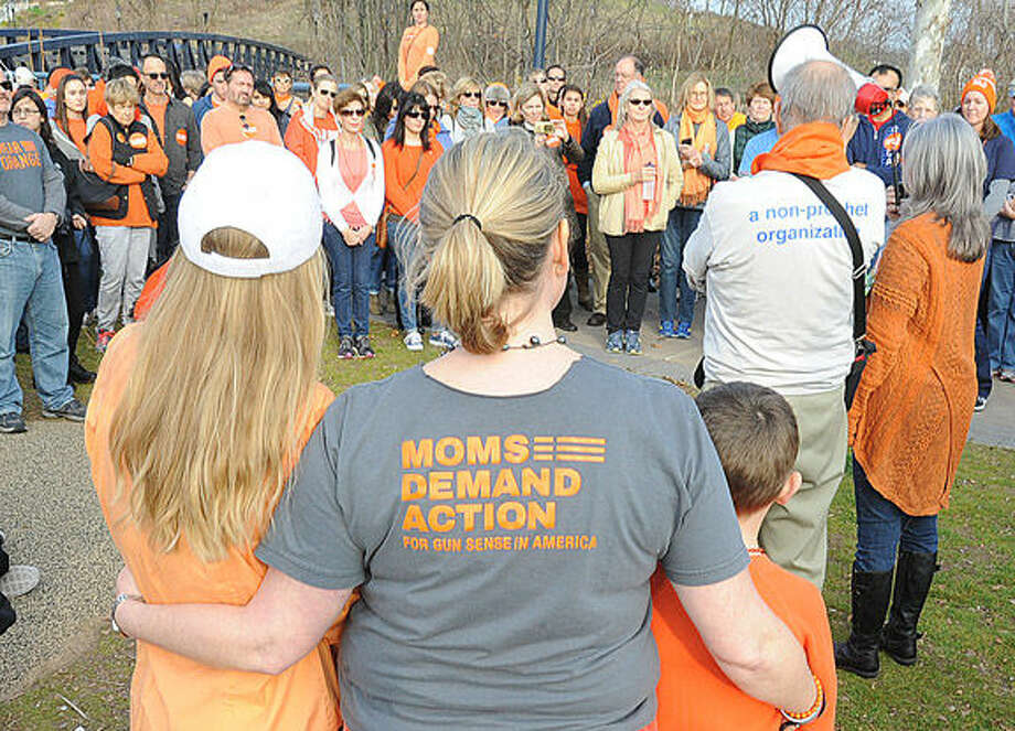 Supporters against gun violence met Sunday at Oyster Shell Park for a rally and walk. hour photo/Matthew Vinci
