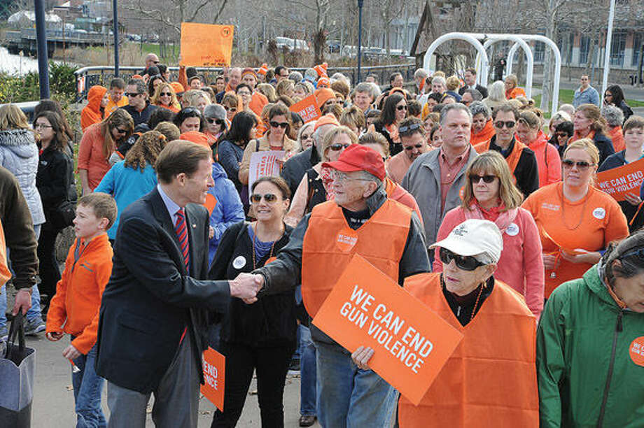 United States Senator Richard Blumenthal leads the walk Sunday at Oyster Shell Park in Norwalk where people in support of gun safety held a rally and walked against gun violence. Hour photo/Matthew Vinci