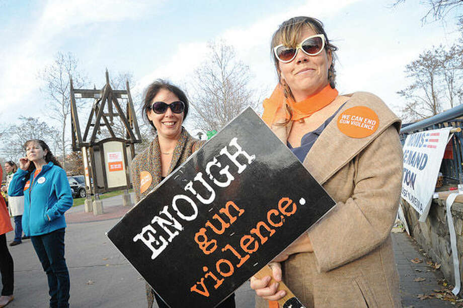Jenny Butler and Christine McGee Sunday at Norwalk Oyster Shell Park to support the cause against gun violence. Hour photo/Matthew Vinci