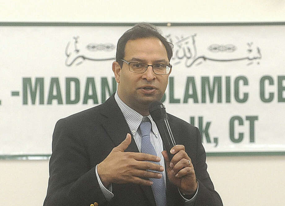 Farhan Memon boardmember with the Islamic Center of Norwalk speaks Sunday at the al Madany Islamic Center in Norwalk. Elected officials and law enforcement met at the center to discuss how the community can work together to prevent discrimination and backlash against Muslims. Hour photo/Matthew Vinci