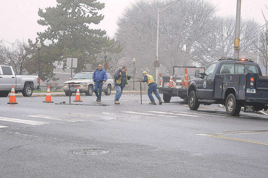A water main break in the areas of Wall Street, High Street and Main Street in Norwalk on Monday. At 11:00 am workers were trying to pinpoint the location of the break. Hour photo/Matthew Vinci