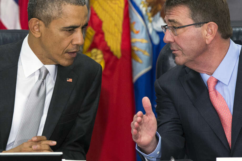 President Barack Obama talks with Defense Secretary Ash Carter during a meeting with the National Security Council about the fight against the Islamic State group, Monday, Dec. 14, 2015, at the Pentagon. (AP Photo/Evan Vucci)
