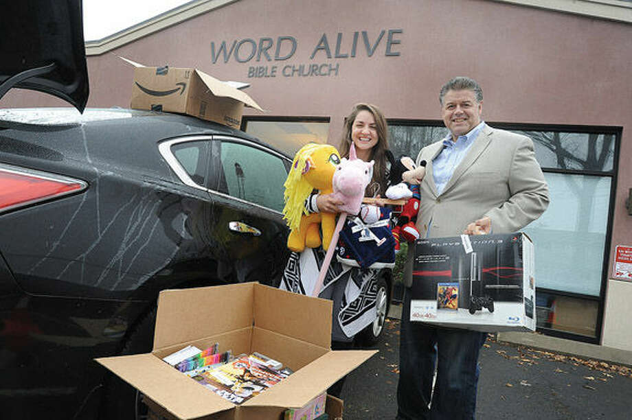 Alyssa Fortunato, member of Word Alive with Artie Kassimis, Word Alive pastor getting ready to donate items Alissa has collected in honor of her brother who died from cancer.Hour photo/Matthew Vinci