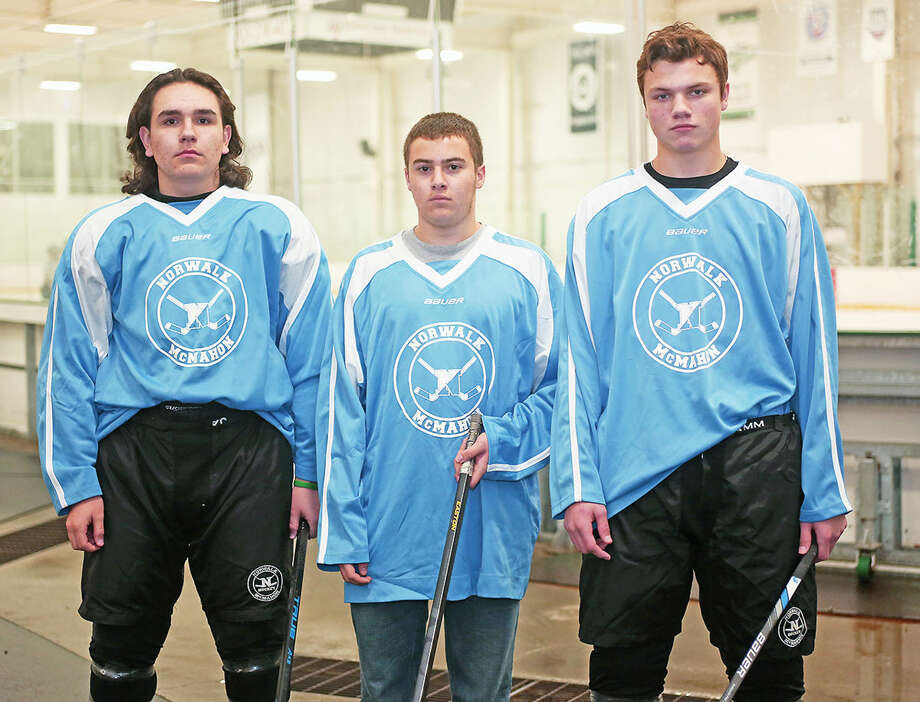 Norwalk/Brien McMahon Hockey Assistant Captain, Patrick Auz and Gavin McCallum with Captain, Matt Cavanagh pose for a photo at the SoNo Ice House Friday afternoon. Hour Photo / Danielle Calloway