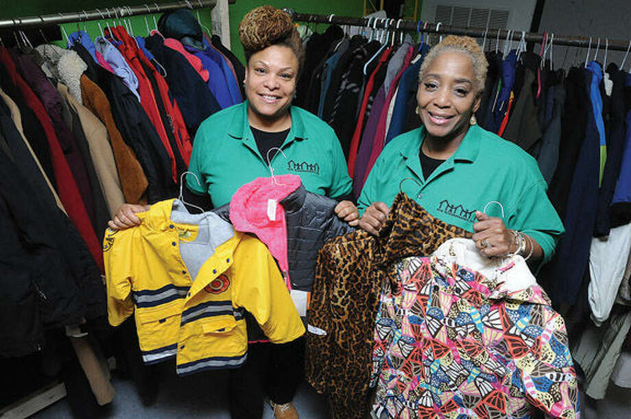 Lorrie Goings, tenant at New Neighborhoods and Vonda Pommills who is a tenant advocate among the coats for the coat drive on Tuesday. New Neighborhoods, Inc. is hosting a charity event to hand out coats and jackets to residents of Stamford's West Side. Photo/Matthew Vinci