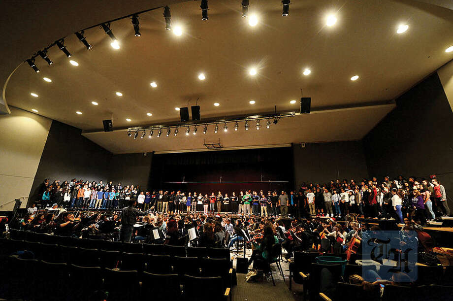 Hour photo / Erik Trautmann The Brien McMahon Chorale and Orchestra practice for their annual Poinsettia winter concert on Tuesday, Dec. 15 at 7 p.m.