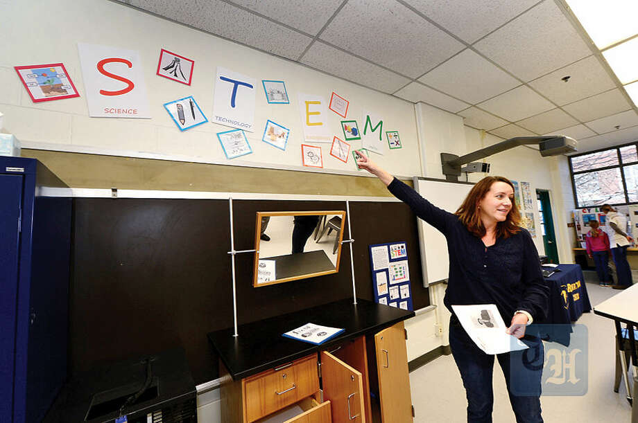 Hour photo / Erik Trautmann PTO co-president Michelle Casey leads a tour of the new STEM classroom following a ribbon-cutting ceremony Saturday for the new wing of Rowayton Elementary School which was completed recently.