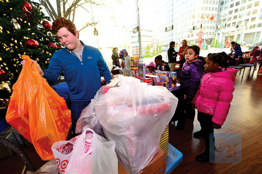 Hour photo / Erik Trautmann NBC staff including Connor Dowling donate toys to the children from the Stamford Boys and Girls Club at NBC's Stamford Media Center Thursday afternoon.
