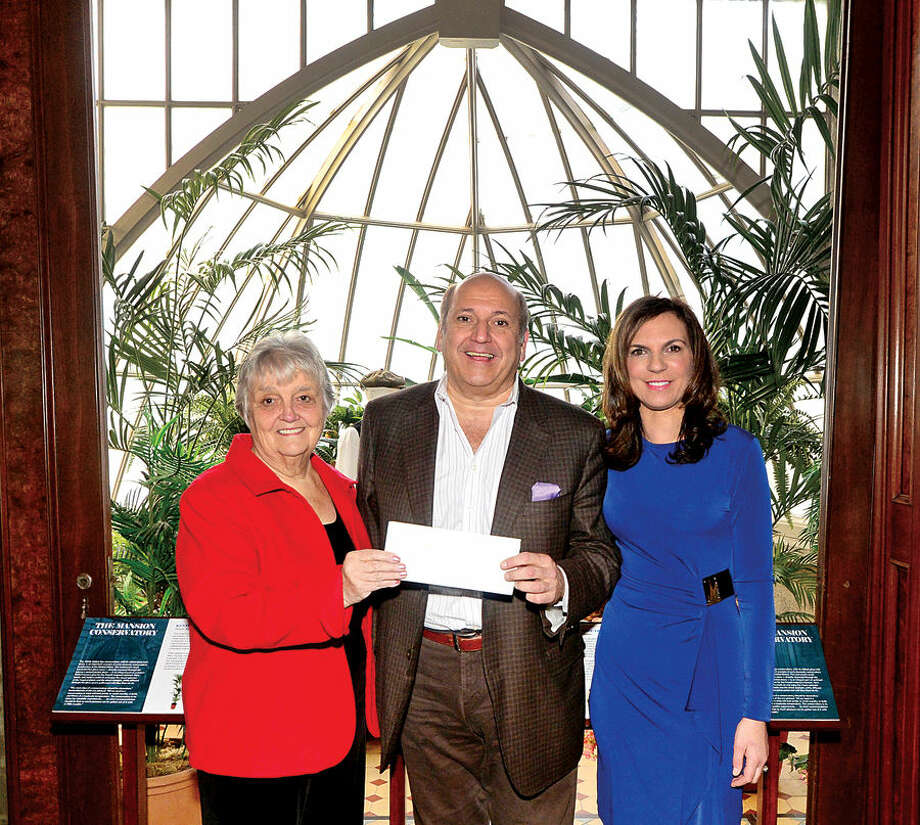 Hour photo / Erik Trautmann Klaff's Chairman and Chief Operating Officer Joe Passero donates a portion of the proceeds from this year's Klaff's Jerry Levine Charity Golf Outing, $8,811.90 to the Lockwood-Mathews Mansion Museum received by chairwoman, Patsy Brescia and Executive Director Susan Gilgore.