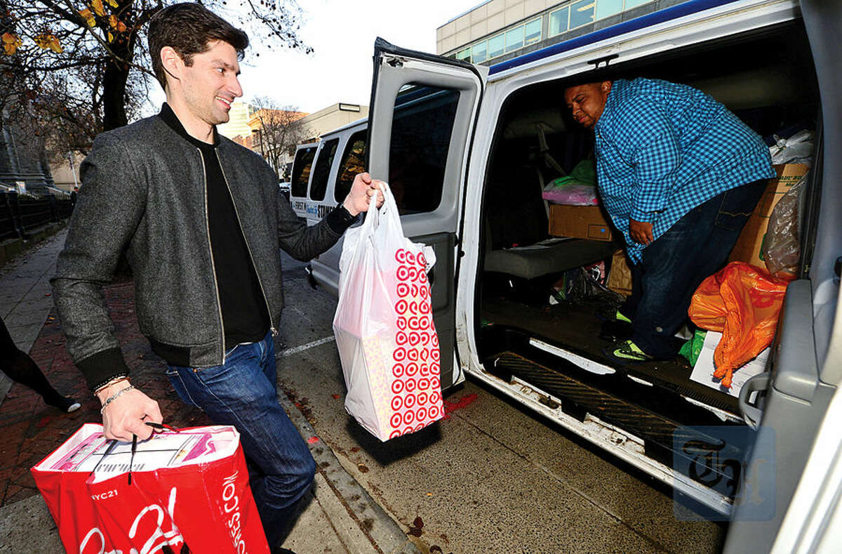 Hour photo / Erik Trautmann NBC staff including Crazy Talk host, Ben Aaron, hand out cookies and donate toys to the children from the Stamford Boys and Girls Club at NBC's Stamford Media Center Thursday afternoon.