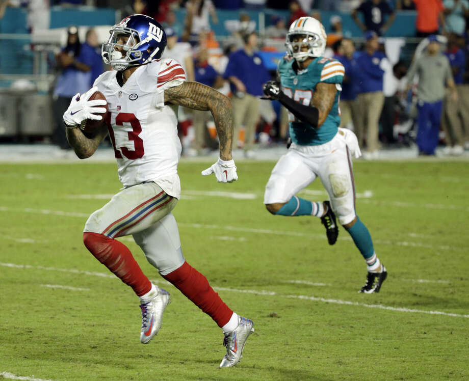 FILE - In this Dec. 14, 2015, file photo, New York Giants wide receiver Odell Beckham (13) runs for a touchdown during the second half of an NFL football gam against the Miami Dolphins, in Miami Gardens, Fla. The 13-0 Panthers take on the New York Giants on Sunday. (AP Photo/Wilfredo Lee, File)