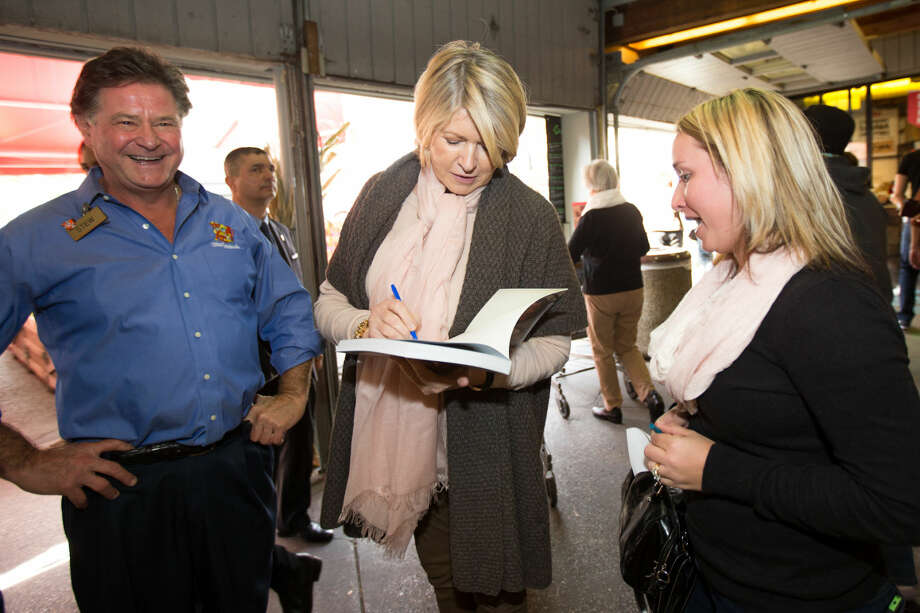 Hour photo / Chris Palermo. Martha Stewart signs a book for Kathleen White of Ithica, N.Y. after Stewart's book signing at Stew Leonard's Saturday.