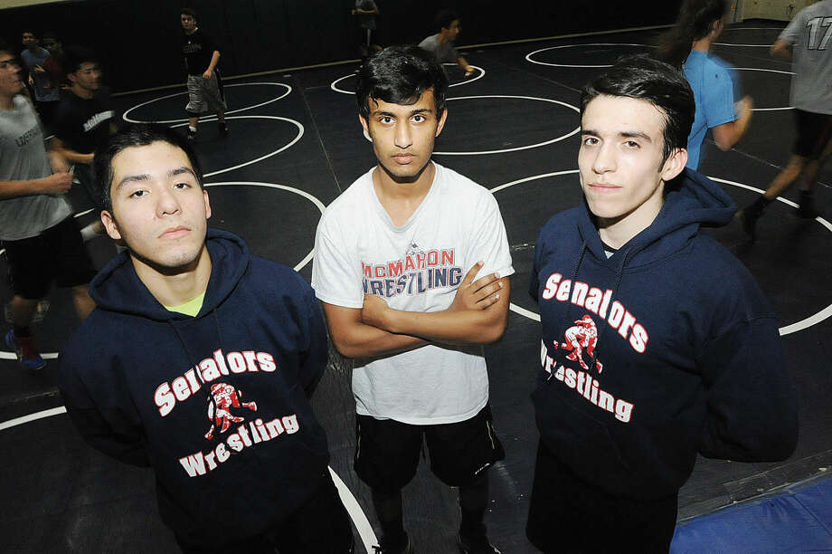 Three of the four Brien McMahon wrestling captains, Aldo Ojeda, Joshua Wyclif and Grorge Gallagher. Marcus Garcia was not available. Hour photo/Matthew Vinci
