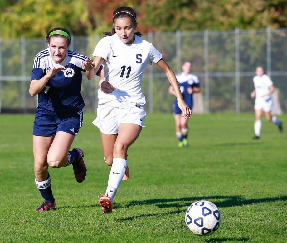 Hour photo/Chris PalermoWilton's Hayley English and Staples' Tia Zajec race for the ball during the Wrecker's win over Wilton Saturday afternoon.