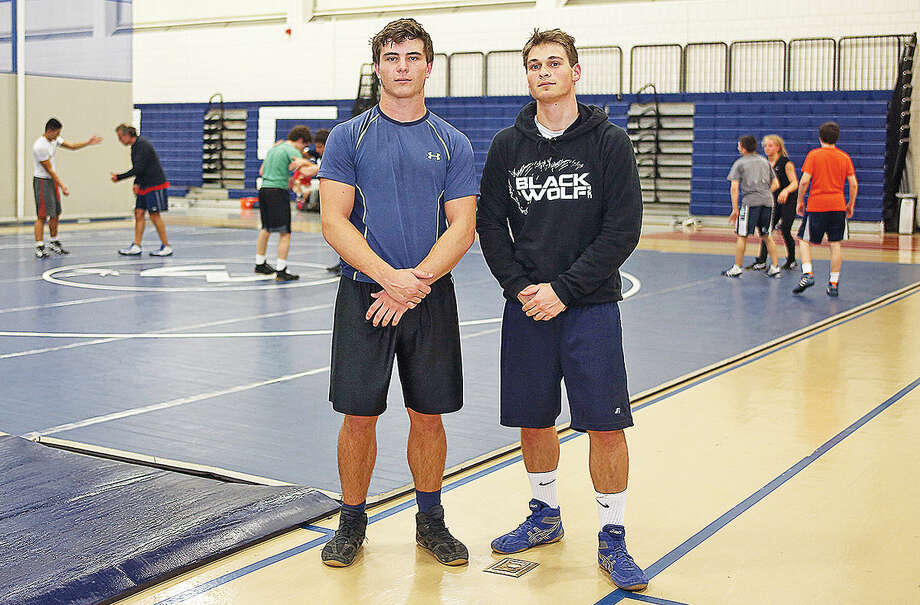 Wilton High School Wrestling Captains, Jared Gladstein and Matt Beck (missing, Quin Reedy) pose for a photo inside the Field House Friday evening. Hour Photo / Danielle Calloway