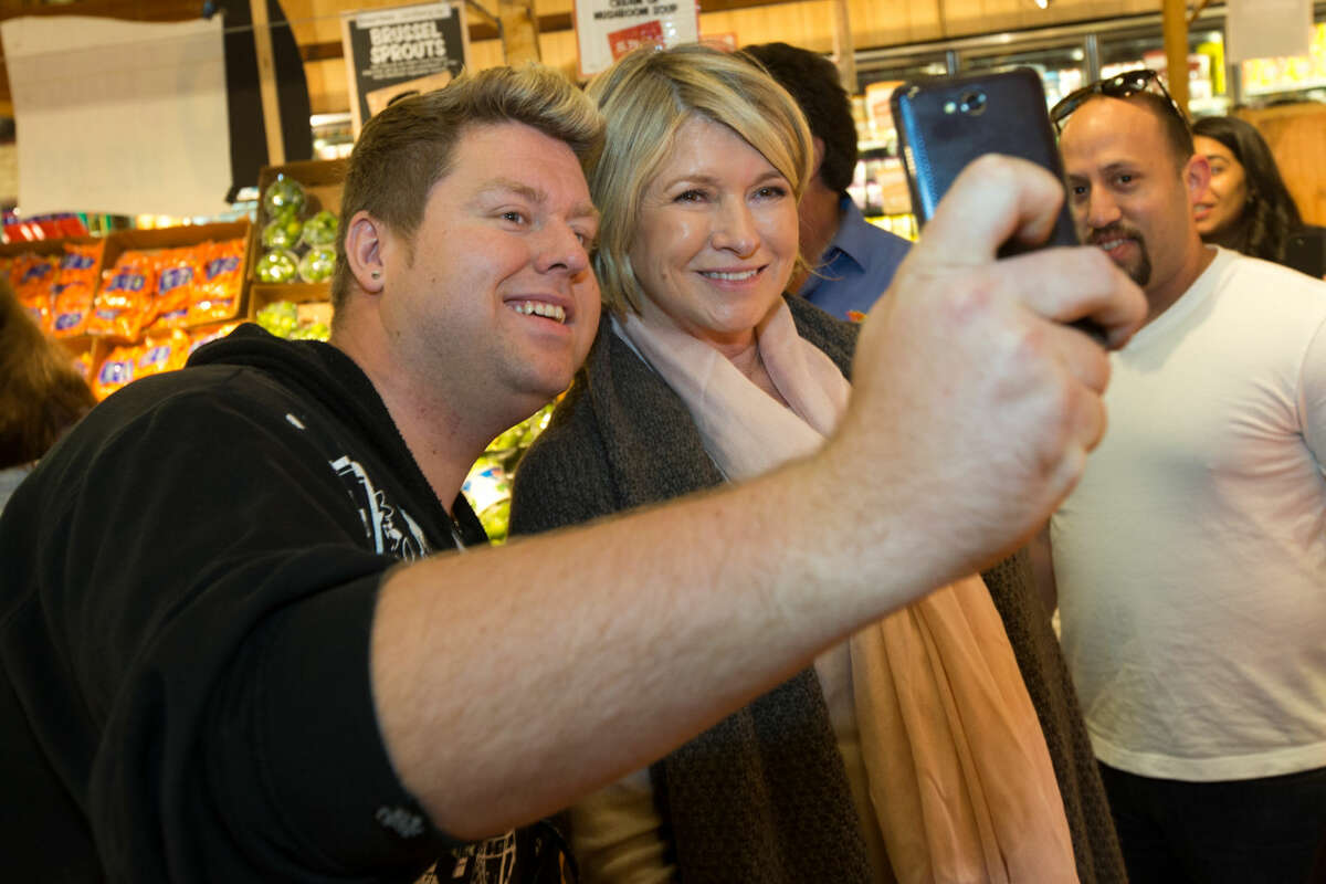Hour photo / Chris Palermo. Mike Smith takes a selfie with Martha Stewart as she takes a stroll through Stew Leonard's after a book signing.