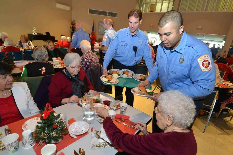 Wilton firefighters serve the Holiday Lunch at Ogden House.