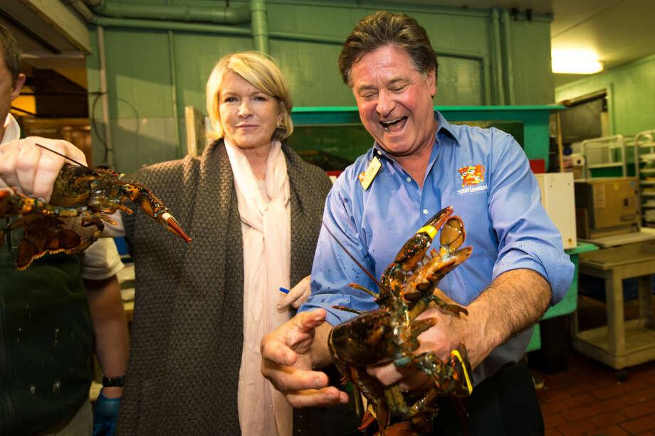 Hour photo / Chris Palermo. Stew Leonard shows Martha Stewart the lobsters after Stewart's books signing at Stew Leonard's Saturday.