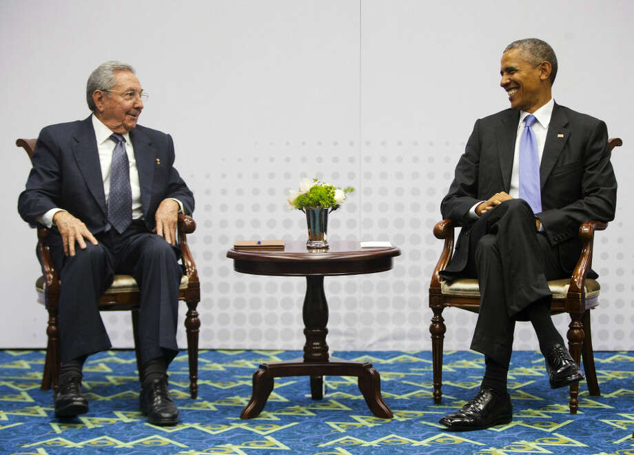 FILE - In this April 11, 2015, file photo, Cuban President Raul Castro, left, and U.S. President Barack Obama meet at the Summit of the Americas in Panama City, Panama, Saturday. The United States and Cuba publicly say they're delighted with the state of diplomatic relations a year after Presidents Barack Obama and Raul Castro declared the end to more than 50 years of official hostility. The two countries have reopened embassies in Havana and Washington; agreed to a pilot program restarting direct mail service; signed two deals on environmental protection; and launched talks on issues from human rights to compensation for U.S. properties confiscated by Cuba's revolution. (AP Photo/Pablo Martinez Monsivais, File)