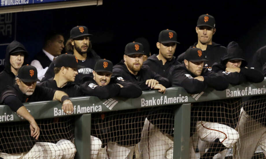 The San Francisco Giants watch from the dugout during the ninth inning of Game 3 of baseball's World Series against the Kansas City Royals Friday, Oct. 24, 2014, in San Francisco. The Royals won 3-2 to take a 2-1 lead in the series. (AP Photo/Eric Risberg)