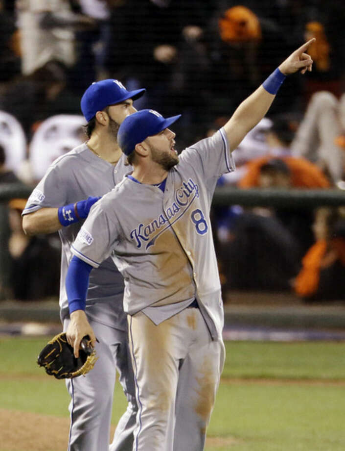 Kansas City Royals' Mike Moustakas celebrates after the Royals' 3-2 win over the San Francisco Giants in Game 3 of baseball's World Series Friday, Oct. 24, 2014, in San Francisco. The Royals lead the series 2-1. (AP Photo/Charlie Riedel)