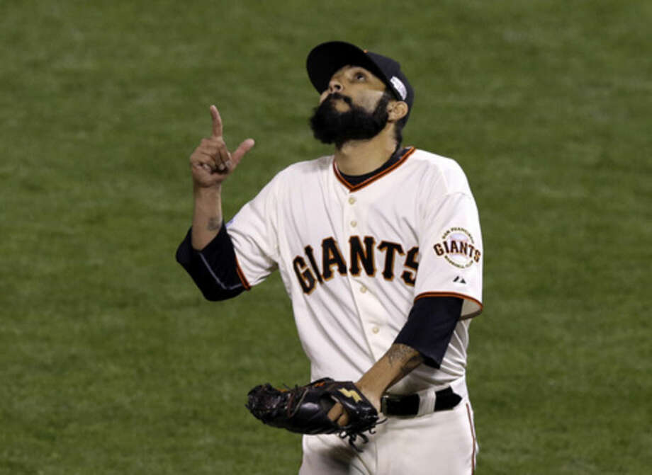 Kansas City Royals pitcher Jason Frasor signals after being relieved during the eighth inning of Game 3 of baseball's World Series against the San Francisco Giants Friday, Oct. 24, 2014, in San Francisco. (AP Photo/Jeff Chiu)