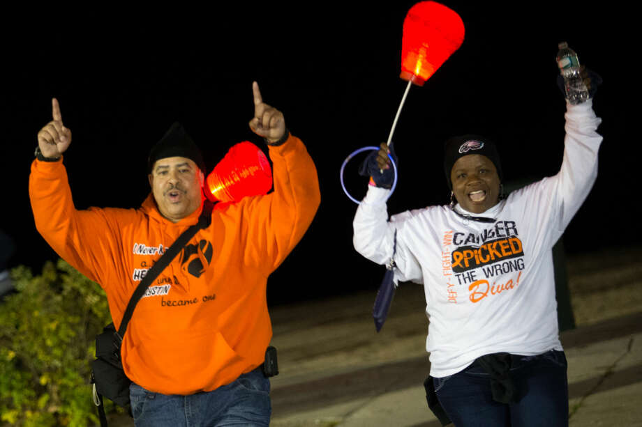 Hour photo/Chris PalermoJeff Baldwin and Cecelia celebrate after completing the Light the Night Friday at Calf Pasture Beach.