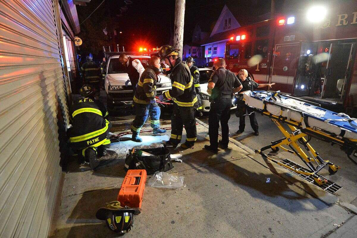 Hour Photo/Alex von Kleydorff Emergency personnel place a man on a gurney after pulling him from underneath a pickup truck that hit three pedestrians on 50 Woodward Ave on Friday night.