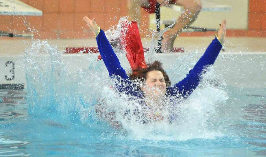 Hour Photo/Alex von Kleydorff Math Teacher Sue Weber gets it done in her own way during the 4th annual Bear Flop Fundraiser hosted by the Bears Beating Cancer Club to benefit Norwalk Hospital's Whittingham Cancer Center.