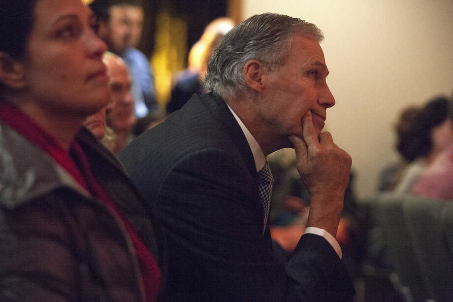 Washington Gov. Jay Inslee listens to a speech during a vigil to honor victims of a shooting at Marysville-Pilchuck High School at The Grove Church in Marysville, Wash., on Friday, Oct. 24, 2014. (AP Photo /The Herald, Ian Terry)
