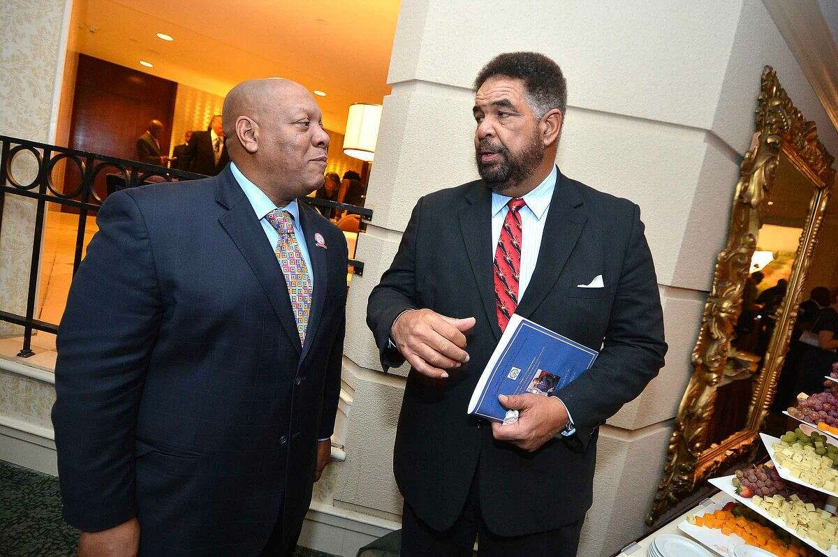 Hour Photo/Alex von Kleydorff Connecticut State Conference of NAACP Branches President Scott Esdaile and honoree Rodney Bass talks during the reception at the Freedom Fund banquet in Stamford Friday night
