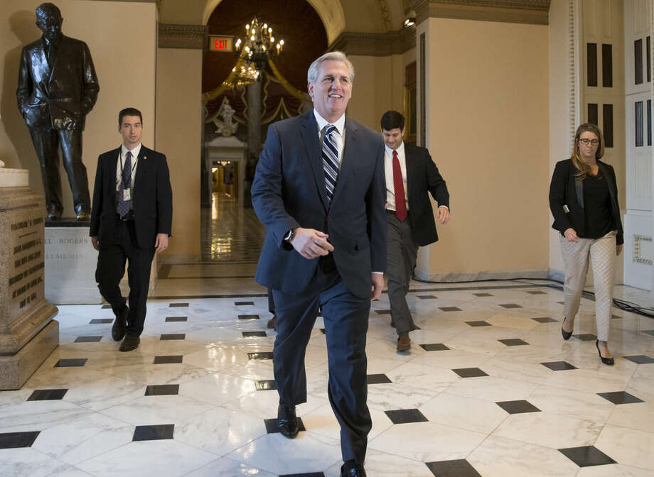 House Majority Leader Kevin McCarthy, R-Calif., smiles as he walks to the House chamber, at the Capitol in Washington, Friday, Dec. 18, 2015. The House on Friday easily passed a $1.14 trillion spending bill to fund the government through next September, capping a peaceful end to a yearlong struggle over the budget, taxes, and Republican demands of President Barack Obama (AP Photo/J. Scott Applewhite)