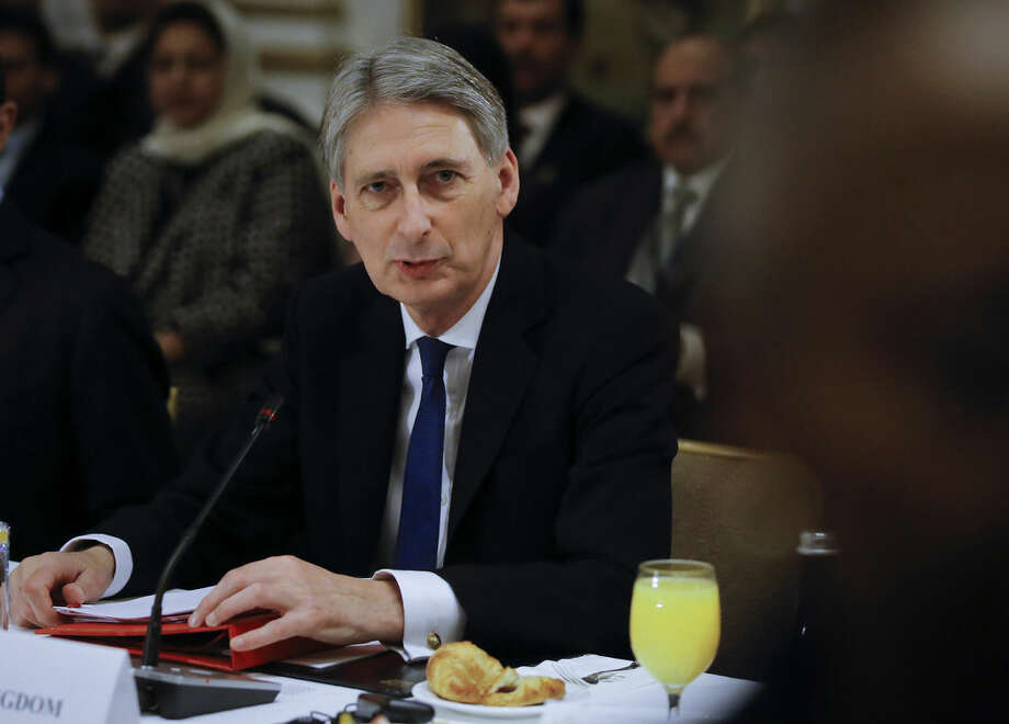 "British Foreign Secretary Philip Hammond talks before a meeting of the International Syria Support Group at a hotel in New York, Friday, Dec. 18, 2015. Nations meeting Friday in New York and the U.N. will essentially be negotiating a Russian plan for a ""political transition,"" based on the Syrian government's consent and with no clear reference to President Bashar Assad's departure. (Carlo Allegri/Pool Photo via AP)"