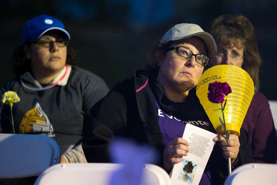 Hour photo/Chris PalermoSupporters pay their respects at the Rememberance Ceremony during the Light the Night Walk Friday at Calf Pasture Beach.