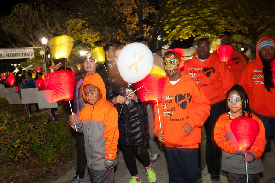 Hour photo/Chris PalermoSupporters begin the Light the Night Walk Friday at Calf Pasture Beach.