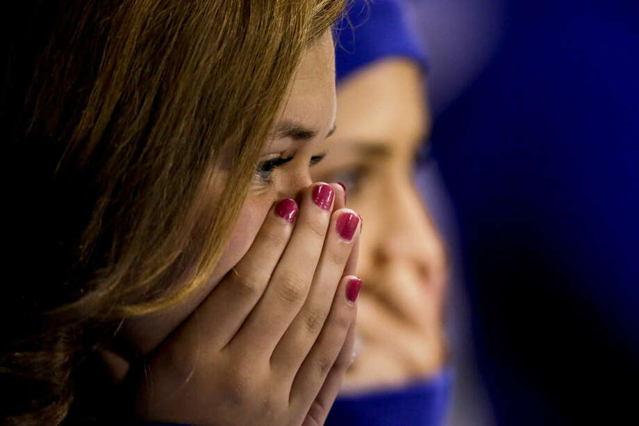 Kansas City Royals fans watch during the eighth inning of Game 7 of baseball's World Series against the San Francisco Giants Wednesday, Oct. 29, 2014, in Kansas City, Mo. (AP Photo/Charlie Riedel)